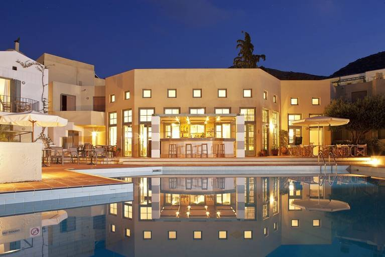 Evening ambiance around the pool of Galaxy Villas, one of the best of Hersonissos Crete hotels, offering serviced apartments and villas with hotel facilities