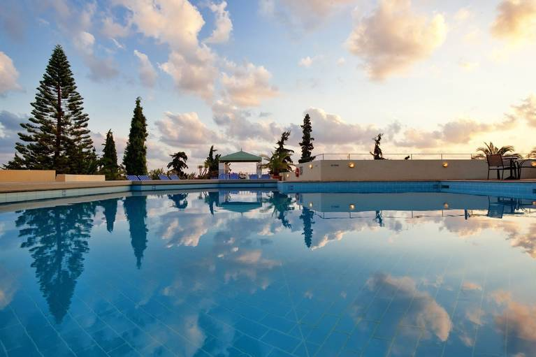 Sky reflections on the Galaxy Villa's swimming pool which guests can enjoy by at staying at one of the resort's villas in Koutouloufari Crete