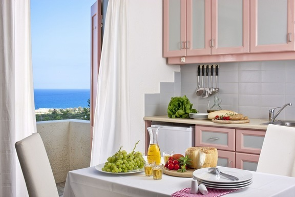 Local Cretan products for a rustic lunch with sea views at Galaxy Villa's Standard Villas in Koutouloufari